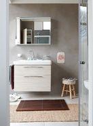 Eigentijdse badkamer met betonlook wandtegels