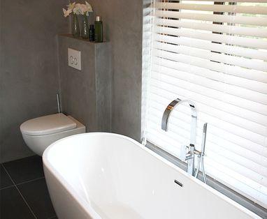 Binnenkijkers - Betonstuc badkamer in Arnhem