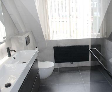 Binnenkijkers - Stijlvolle badkamer in Vught