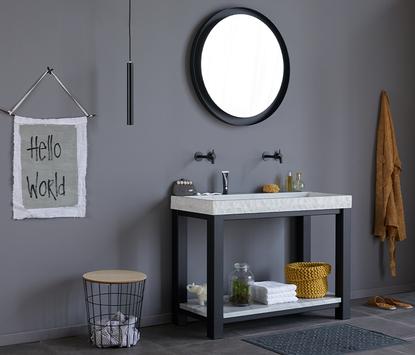 Trendy natuurstenen wastafel met stalen frame