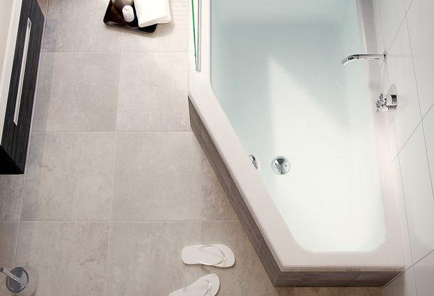 Tips voor een kleine badkamer met bad - Een kleine badkuip of hoekbad